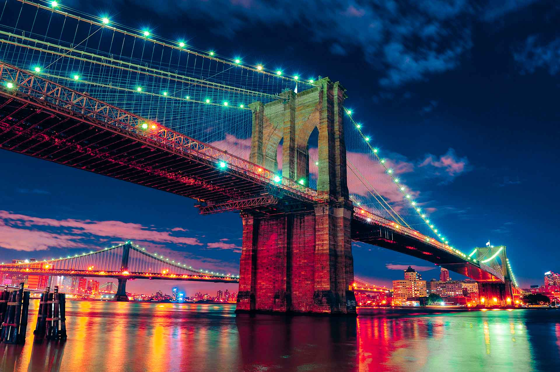 the Brooklyn Bridge at night in New York City